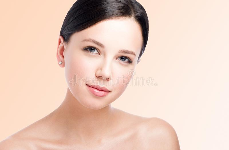 Closeup beauty portrait of beautiful young woman. Perfect clean skin royalty free stock image