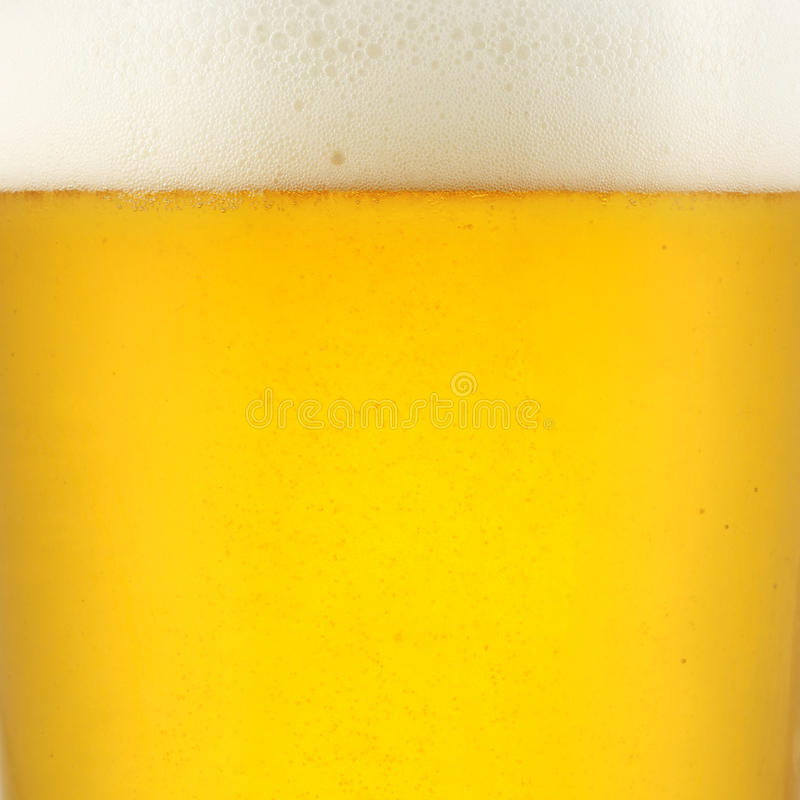 Closeup of beer. And creamy foam stock photography