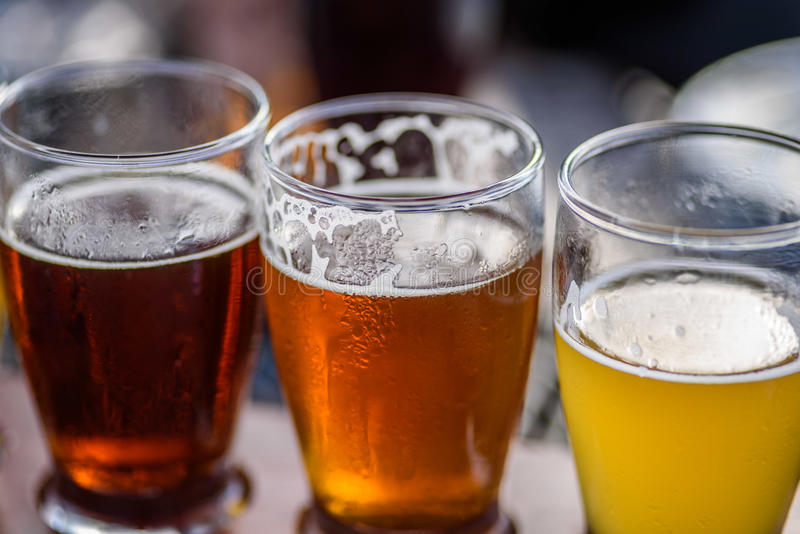 Closeup of a beer flight outside on a sunny day stock image
