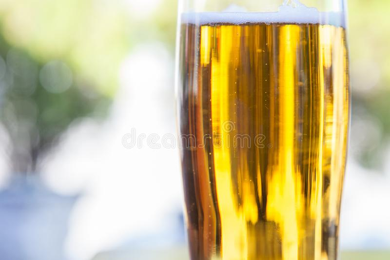 Closeup on a beer mug containing a light beer, pilsner / lager style, served in a standard pint size glass stock images