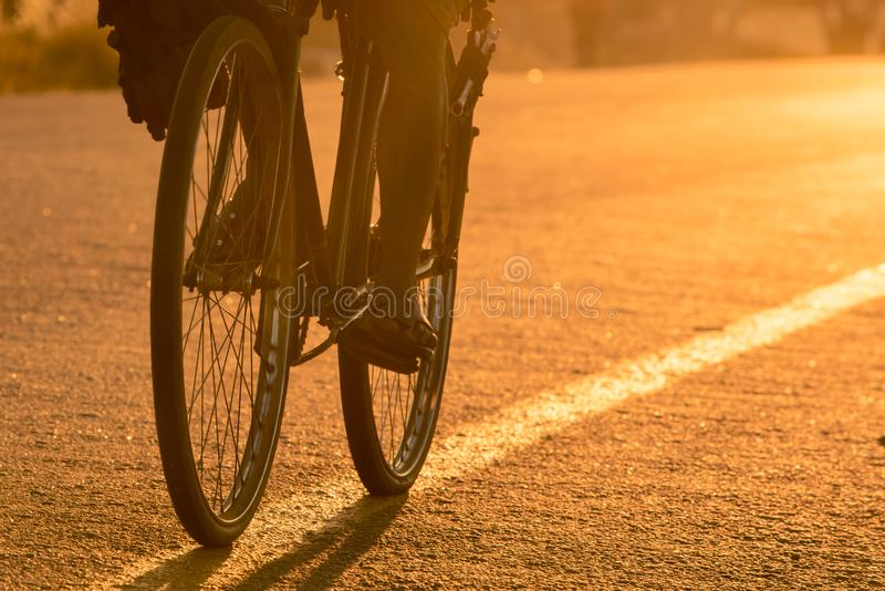Closeup of bicycle wheels/tires on an asphalt road royalty free stock image