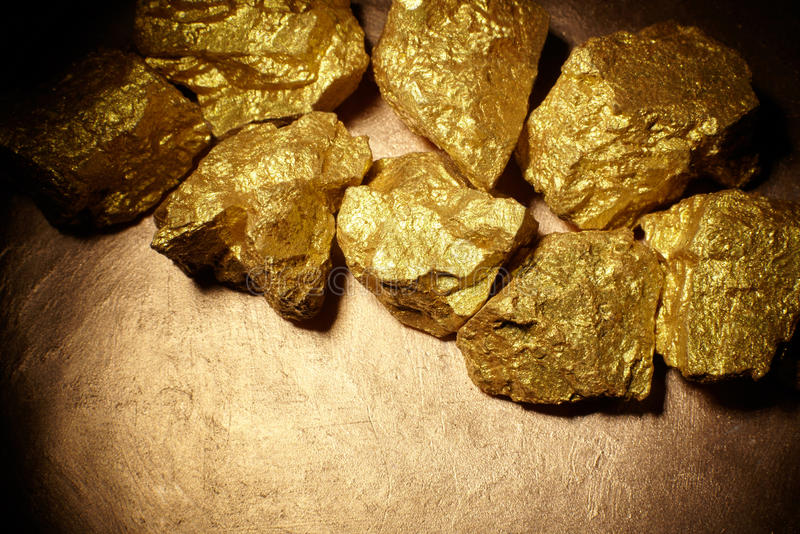Closeup of big gold nuggets. Finance concept stock photography