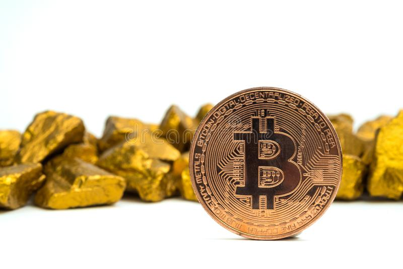 Closeup of bitcoin digital currency and gold nugget or gold ore on white background, precious stone or lump of golden stone, stock images