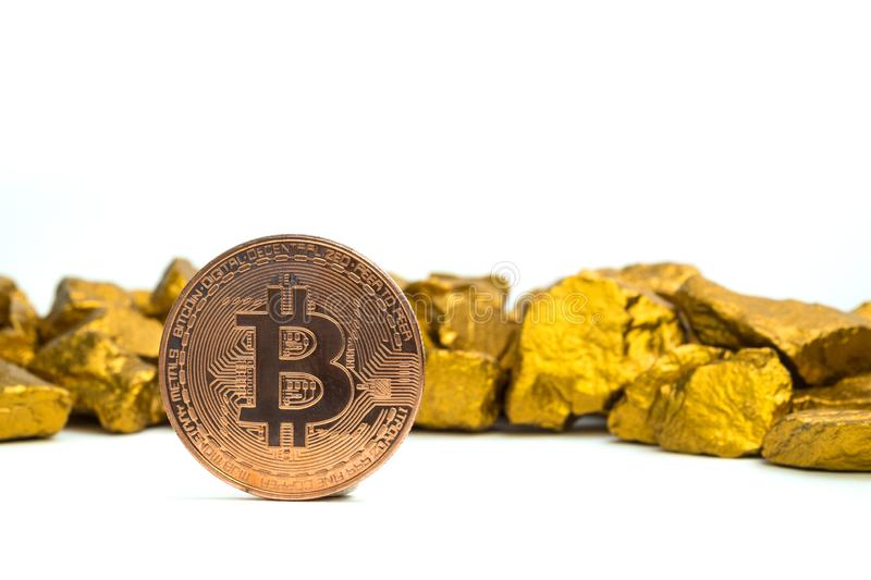 Closeup of bitcoin digital currency and gold nugget or gold ore on white background, precious stone or lump of golden stone, stock photos