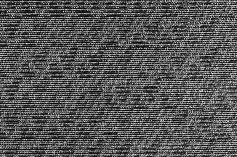 Closeup black ,dark grey color fabric sample texture backdrop. Dark grey fabric strip line pattern design,upholstery for decoratio. N interior design or abstract stock photography