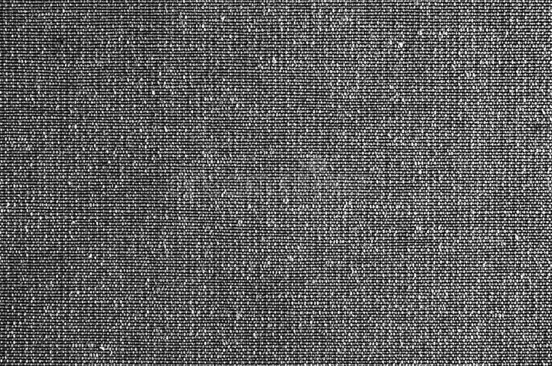 Closeup black or dark grey colors fabric sample texture. Black Fabric pattern design or upholstery abstract background. Closeup black or dark grey colors fabric stock images