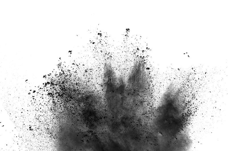 Closeup of black dust particles splash isolated on background. Black powder explosion. The particles of charcoal splatter on white background. Closeup of black stock photos