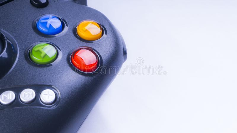 Closeup of black game controller isolated on white background stock images
