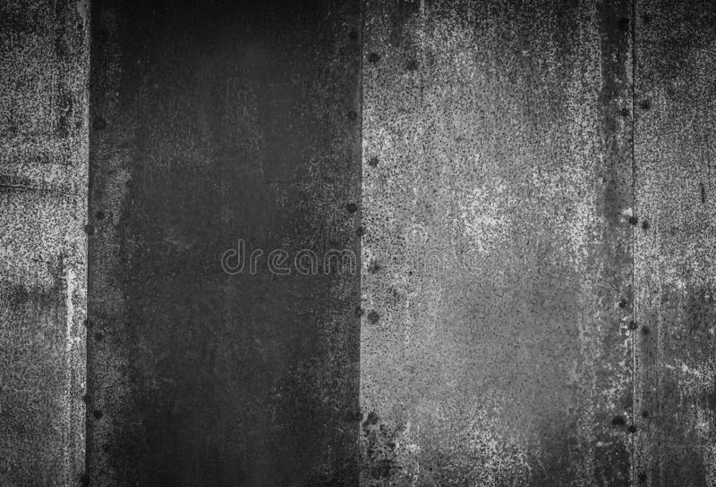 Closeup of black and white metal rust grunge background texture. Rusted, old, vintage, retro background texture royalty free stock images