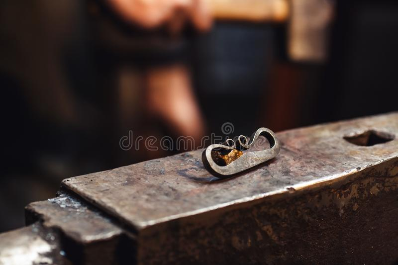 Closeup of a blacksmith anvil with a firesteel and flint. stock photography