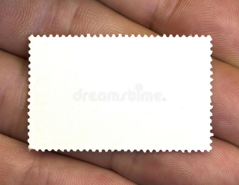 Stamp in the hand royalty free stock image