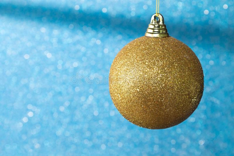 Closeup of Blue bauble hanging from a decorated Christmas tree.Christmas tree decoration background royalty free stock photography