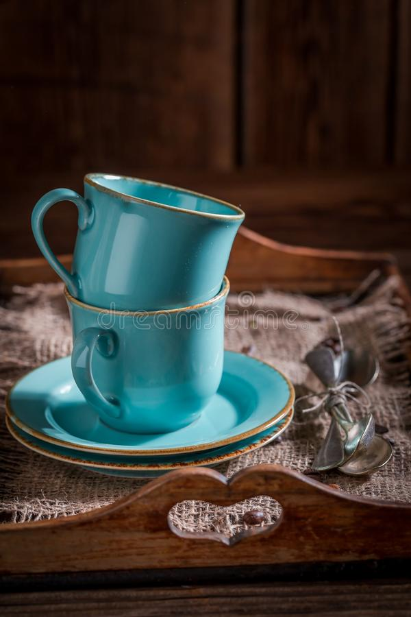 Closeup of blue coffee cup and on burlap napkin. On old wooden table royalty free stock image