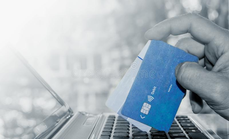 Closeup of blue credit card holded by hand. Image stock photo