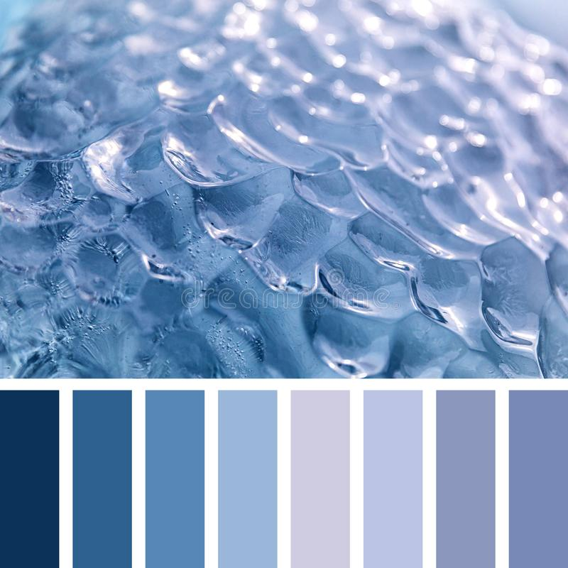 Glacier blue ice palette. Closeup of blue glacial ice in the arctic ocean, Svalbard, in a colour palette with complimentary colour swatches stock images