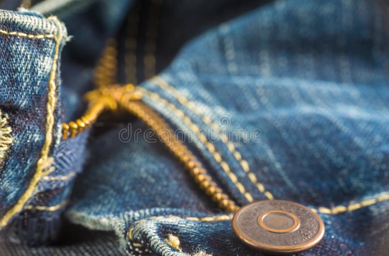 Closeup on blue jeans zipper and button. Denim, background, border, canvas, casual, clasp, cloth, clothing, color, cotton, country, design, detail, element royalty free stock photography