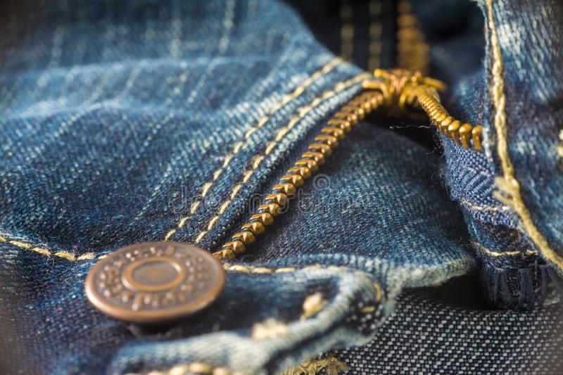 Closeup on blue jeans zipper and button. Denim, background, border, canvas, casual, clasp, cloth, clothing, color, cotton, country, design, detail, element royalty free stock photo