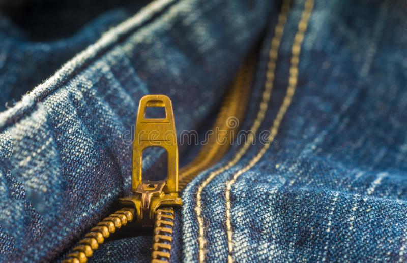 Closeup on blue jeans zipper and button. Denim, background, border, canvas, casual, clasp, cloth, clothing, color, cotton, country, design, detail, element royalty free stock photos
