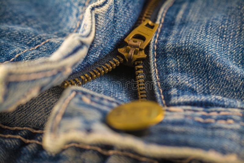 Closeup on blue jeans zipper and button. Denim, background, border, canvas, casual, clasp, cloth, clothing, color, cotton, country, design, detail, element stock image