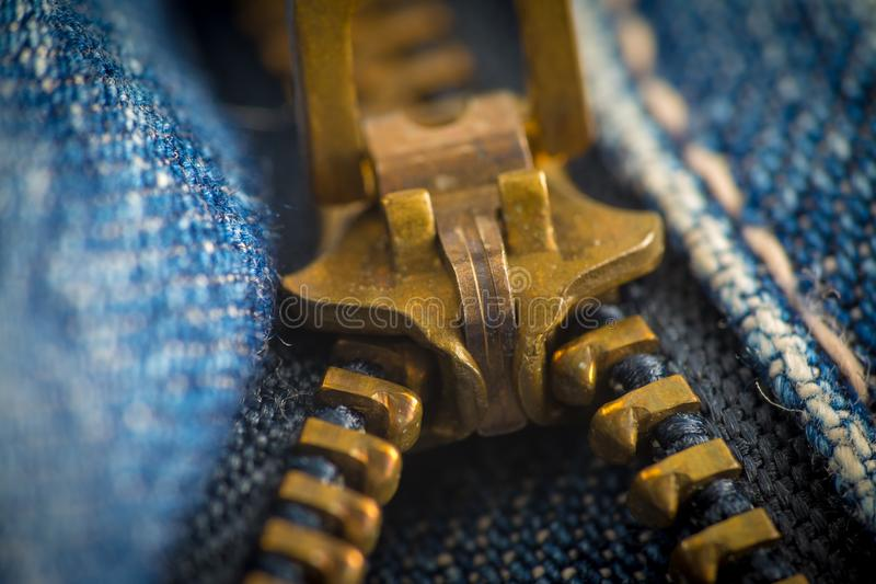 Closeup on blue jeans zipper and button. Denim, background, border, canvas, casual, clasp, cloth, clothing, color, cotton, country, design, detail, element stock images