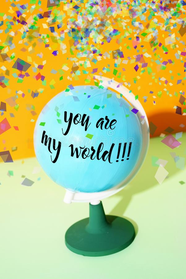 Text you are my world in a globe royalty free stock image