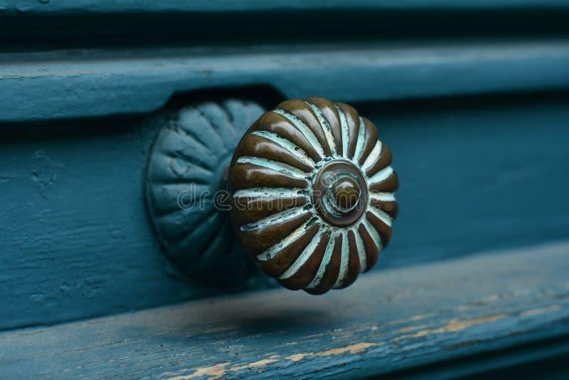 Closeup of blue turquoise old antique door with door handle royalty free stock image
