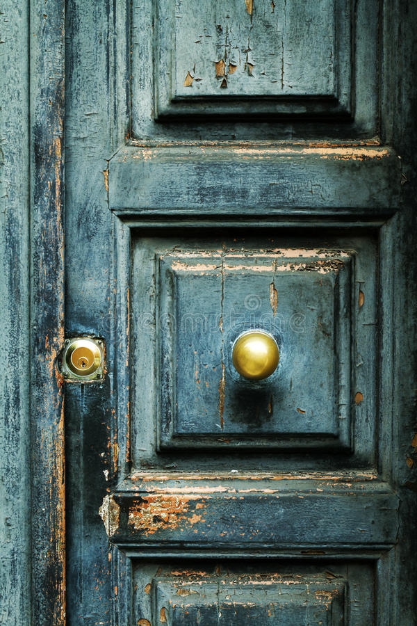 Closeup of blue turquoise old textured antique door with gold br. Blue turquoise old textured antique door. Macro royalty free stock images