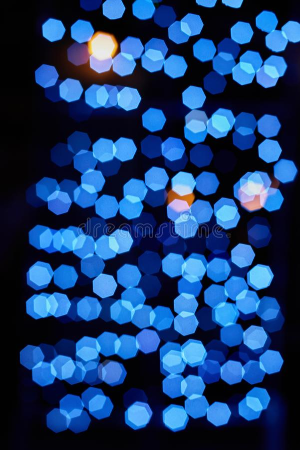 Blured sparkle background. Closeup of blurred dark christmas background with sparkle lights royalty free stock image