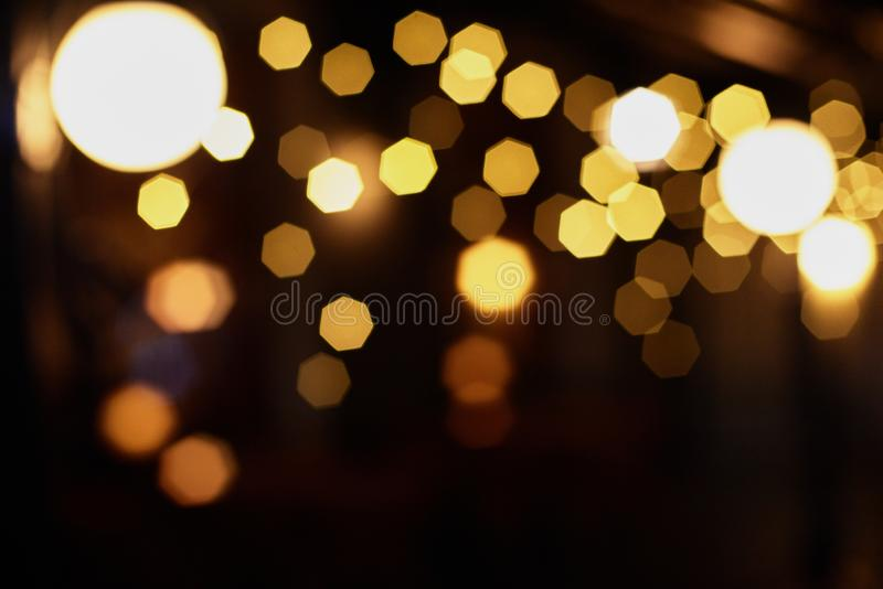 Blured sparkle background. Closeup of blurred dark christmas background with sparkle lights royalty free stock photo