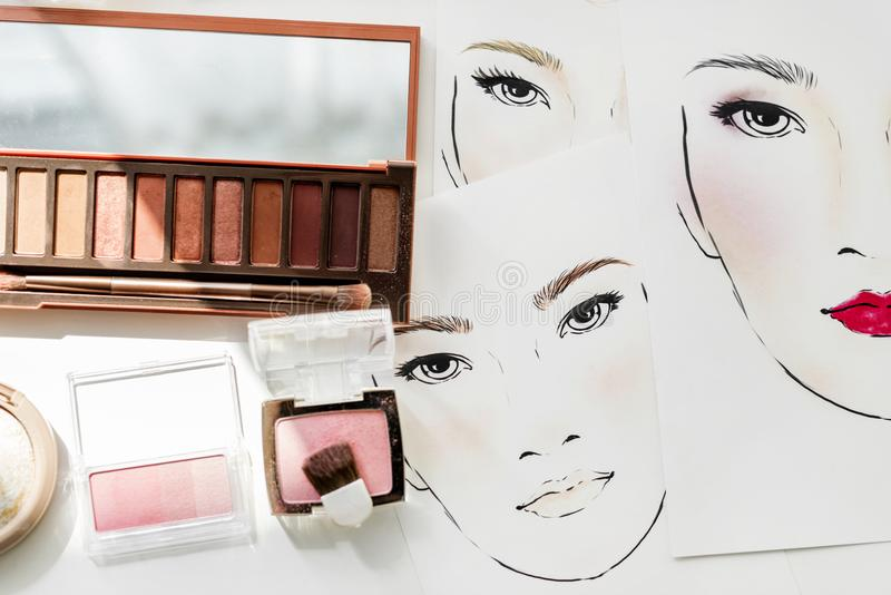 Closeup of blushers and eyeshadow on face charts stock photo