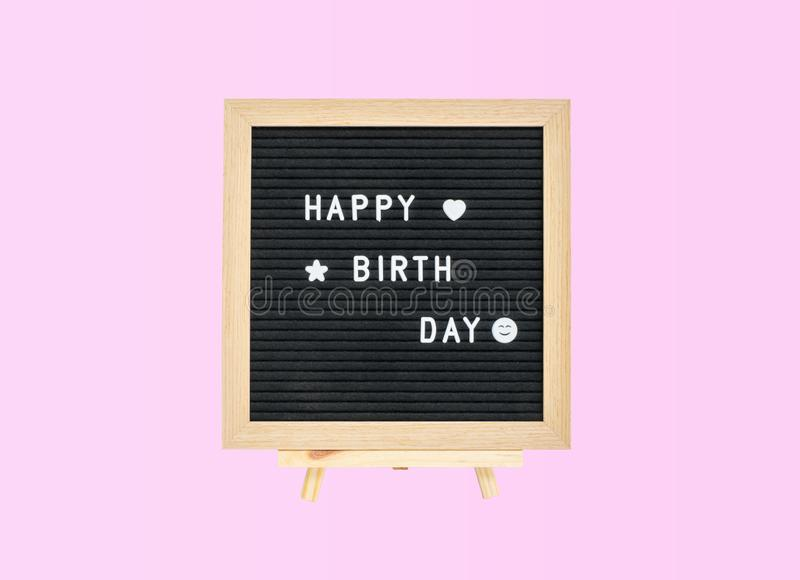 Closeup a board with happy birth day word isolated on pink background. Closeup board with happy birth day word isolated on pink background royalty free stock images