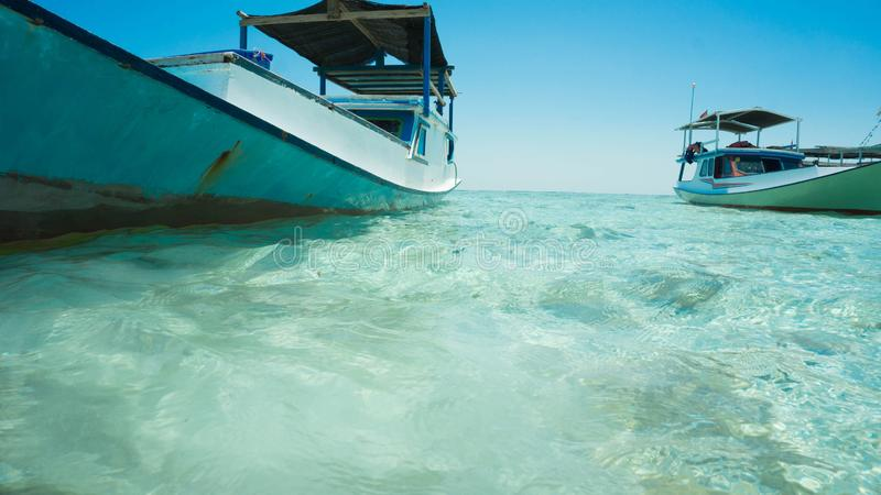 Closeup boat with green sea and traditional boat shoot from behind or under sea royalty free stock images