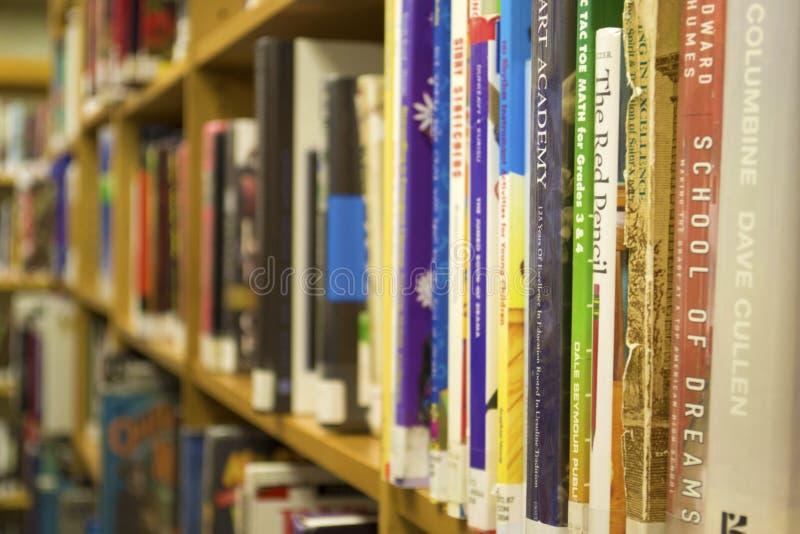 Closeup of Books on a Bookshelf. Closeup of Library books sitting on a bookshelf inside of a library stock photos