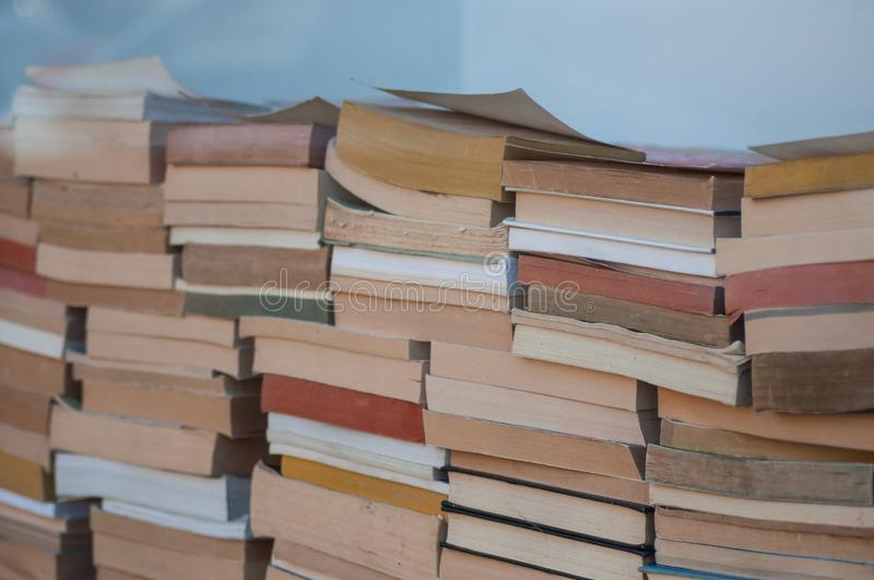 Books pile in Bookstore. Closeup of books pile in Bookstore royalty free stock image