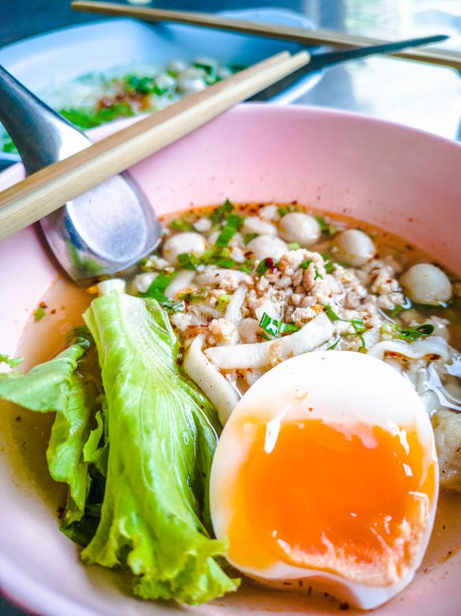 Closeup Bowls of  Spicy Fish Noodle Soup with Fish Balls. Spicy Fish Noodle Soup with Egg and Fish Balls hot meal seafood asia asian boiled bowl broth chili royalty free stock photo
