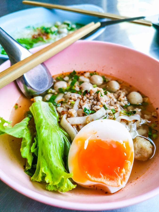 Closeup Bowls of  Spicy Fish Noodle Soup with Fish Balls. Spicy Fish Noodle Soup with Egg and Fish Balls hot meal seafood asia asian boiled bowl broth chili royalty free stock image
