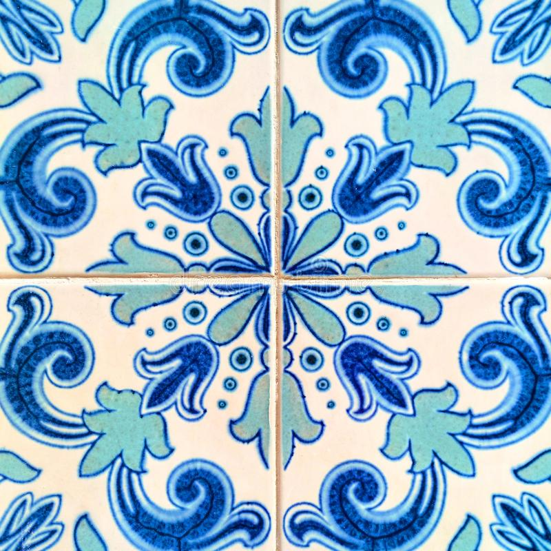 A closeup of bright blue and cyan coloured Portuguese tiles stock images
