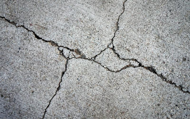 Closeup of broken or damaged cement floor royalty free stock image