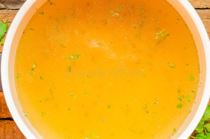 Closeup of broth, clear soup or bouillon in a saucepan royalty free stock photo