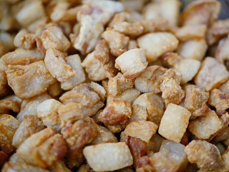 Brown crispy deep fried pork lard crackling Gag Moo / khaep mu. Closeup of brown crispy deep fried pork lard crackling Gag Moo / khaep mu - famous and popular royalty free stock images