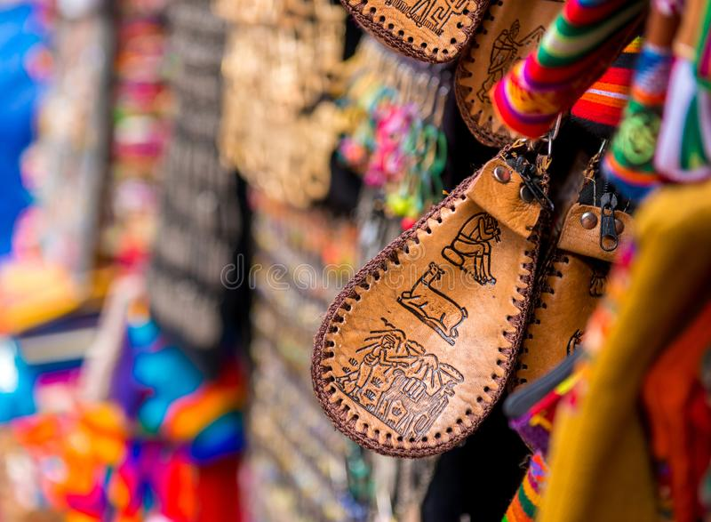 Closeup of brown leather small handbag on the souvenir store in Bolivia. Closeup of brown leather small handbag with patterns on the souvenir store in Bolivia stock images