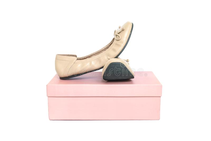 Closeup brown woman shoes on pink paper box of shoes isolated on white background. Closeup woman shoes on pink paper box of shoes isolated on white background royalty free stock images