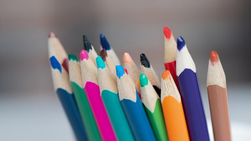 Closeup of bunch of wooden sharpened colored pencils royalty free stock photography