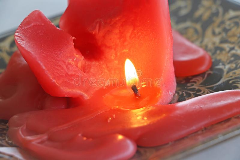 A red candle. Closeup of burning red candle stock images