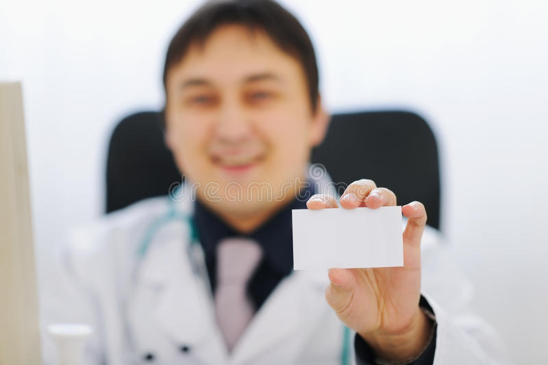Closeup on business card in hand of doctor royalty free stock images