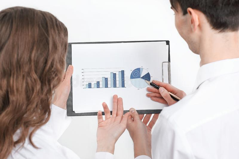 Closeup.business colleagues discussing a financial chart. business concept royalty free stock photography