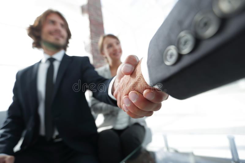 Closeup of a business hand shake stock images