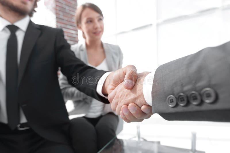 Closeup of a business hand shake royalty free stock photos