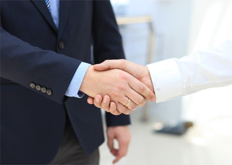 Closeup of a business hand shake stock photos
