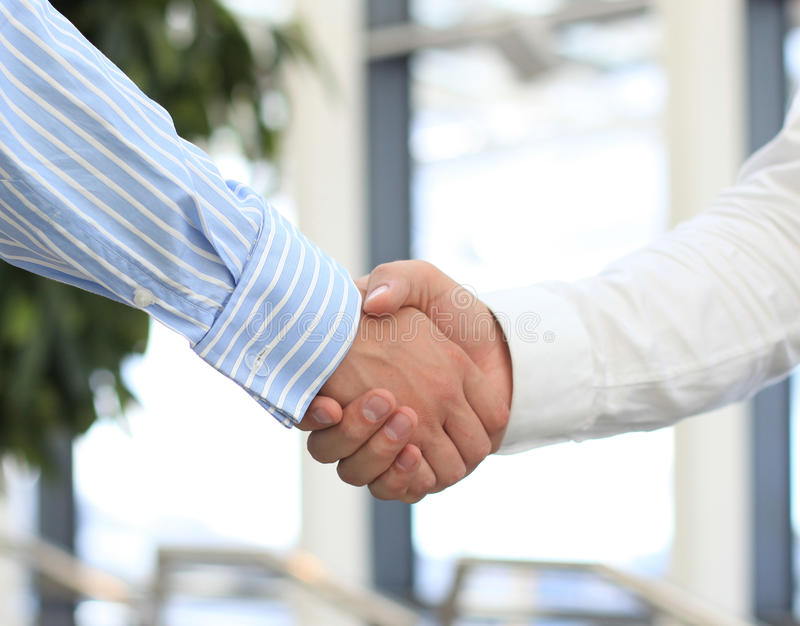 Closeup of a business hand shake royalty free stock photo